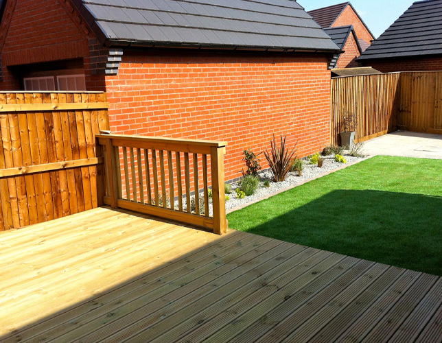 Newly fitted decking with fence & new grass area created by Outback Landscapes.
