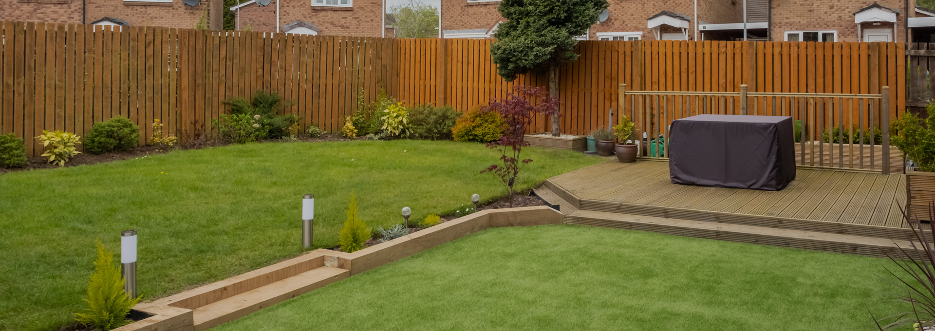 Landscaping project that included designing decking area & grass area in the garden.