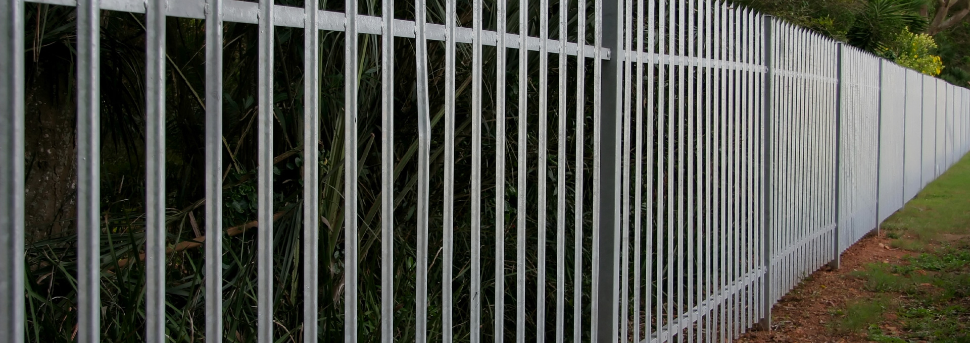 Strong metal fence fitted by Outback Landscapes experts.