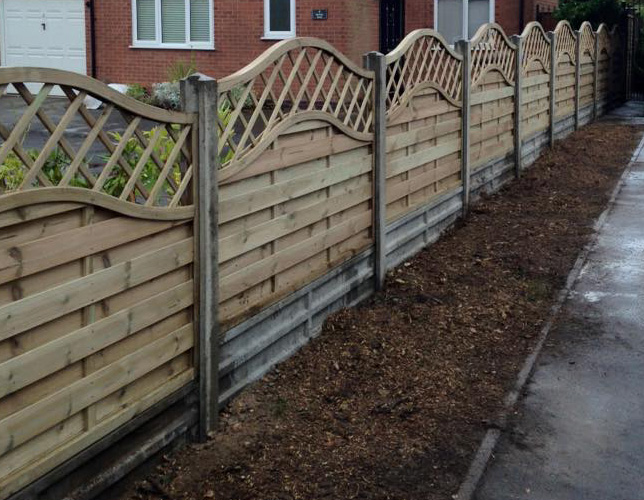 Decorative wooden fence fitted in between of two properties.