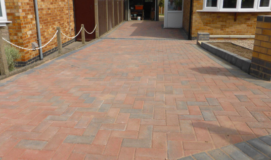 Long brick driveway fitted by Outback Landscapes.