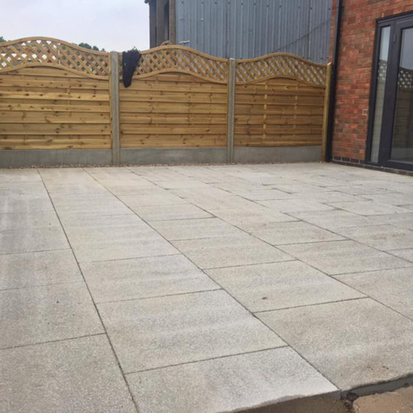 Large square area which has been converted into paved patio.