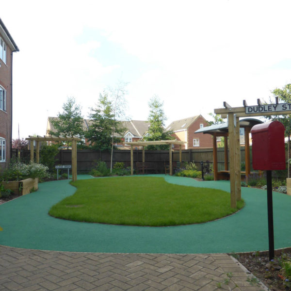 Landscaping project which included laying a new layer of grass & plants in the back of the town house.