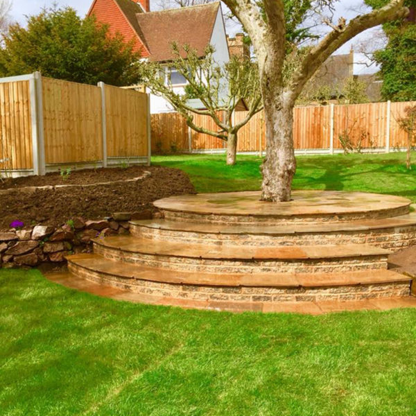 Landscaping project that included stairs area and paving around the tree.