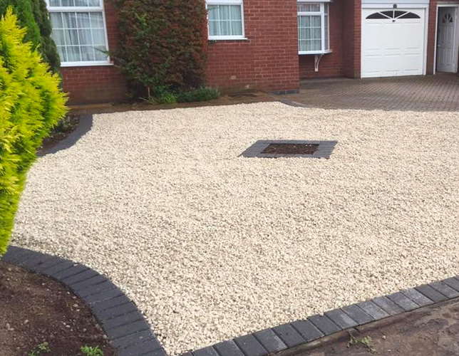 Gravel Driveway fitted near the brick house by Outback landscapes specialists.