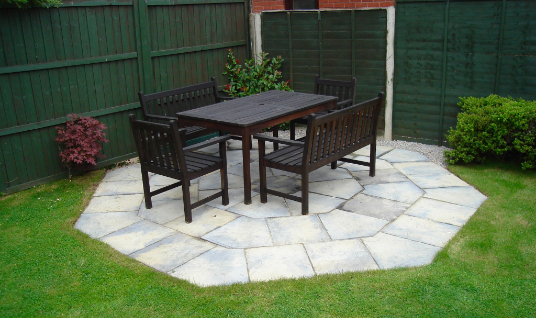 Small project which included heptagon patio fitting, near the green fence in the garden.